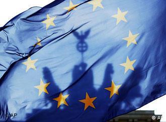 A European flag against a backdrop of the Brandenburg Gate