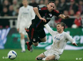 Petersburg's Igor Denisov, right, and Munich's Franck Ribery, left, challenge for the ball during the semi final first leg UEFA Cup match between FC Bayern Munich and FC Zenit St. Petersburg in Munich.