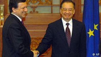 European Commission President Jose Manuel Barroso, left, shakes hands with Chinese Prime Minister Wen Jiabao