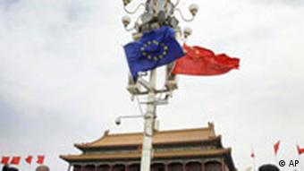 Visitors walk under flags of European Union and China in front of The Tiananmen Gate in Beijing Friday, April 25, 2008. Chinese and European Union leaders launched a high-level dialogue Friday on tensions over China swelling trade surplus with Europe disagreements over how to tackle climate change. (AP Photo/Andy Wong)