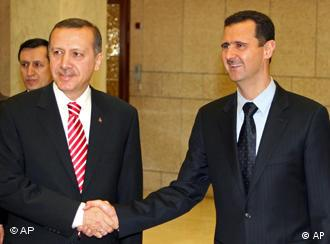 ** CORRECTS SPELLING ** Syrian President Bashar Assad, right, shakes hands with the Turkish Prime Minister Recep Tayyip Erdogan at Ash-Shaeb presidential palace in Damascus, Syria, Saturday, April 26, 2008. Erdogan flew to Syria to brief Assad on the Israeli Prime Minister Ehud Olmert's peace overture. Israel and Syria's last round of direct talks broke down in 2000. (AP Photo/ Bassem Tellawi)