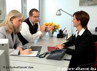 Woman being interviewed in an office
