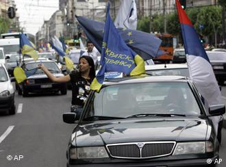 Democratic Party supporters waving flags in downtown Belgrade