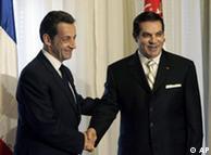 French President Nicolas Sarkozy, left, poses with Tunisian President Zine El Abidine Ben Ali