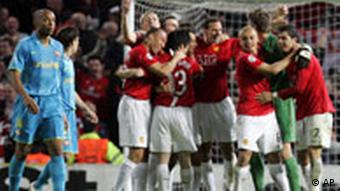 Manchester United players celebrate on the final whistle of a Champions League semifinal