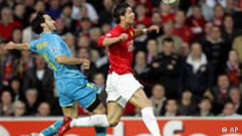 Manchester United's Cristiano Ronaldo, right, battles for the ball with Barcelona's Gianluca Zambrotta during their Champions League semifinal second leg soccer match at Old Trafford stadium in Manchester, England, Tuesday April 29, 2008.