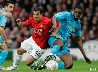 Manchester United's Carlos Tevez, left, battles for the ball with Barcelona's Yaya Toure, right, during their Champions League semifinal second leg soccer match at Old Trafford stadium in Manchester, England, Tuesday April 29, 2008. (AP Photo/Paul White)
