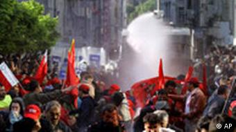 Riot police use water cannon and tear gas to desperse workers during a Labor Day demonstration in Istanbul, Turkey