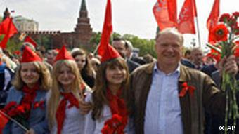 Communist Leader Gennady Zyuganov leads a procession of red, hammer-and-sickle flags and portraits of Lenin and Stalin, on his way to a rally marking the May Day holiday in Moscow