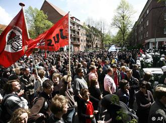 Left wing demonstrators stand in front of a police barricade during a May Day demonstration in Hamburg