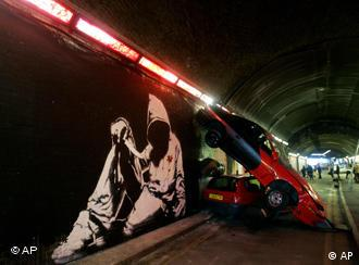 A work by British graffiti artist known as Banksy is seen in an abandoned access road in London