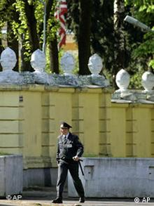 A Belarus police officer patrols near the US Embassy in Minsk