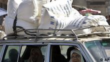 Palestinian women sit in a car, carrying sacks of flour supplied by the UN Relief and Works Agency, (UNRWA), at a warehouse in the Shatie refugee camp, in Gaza City, Sunday, May 4, 2008. The blockade has caused shortages of fuel, cement and other basic items and has deepened unemployment in the impoverished territory. Israel blames Hamas for holding up fuel supplies and causing an artificial crisis. (AP Photo/Khalil Hamra)