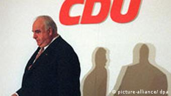 Former Chancellor Helmut Kohl is front of a CDU party sign