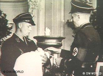 Nazi officers with a Lebensborn child during a naming ceremony