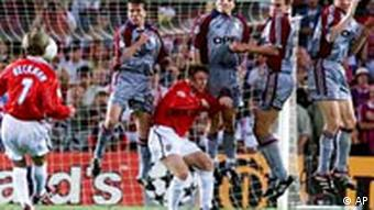 Manchester United's David Beckham takes a free kick as the Bayern Munich players jump to defend their goal during their UEFA Champions Cup final soccer match in Barcelona Wednesday May 26 1999. (AP Photo/Phil Noble) U