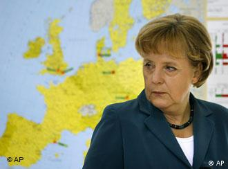 German chancellor Angela Merkel with map of Europe in background