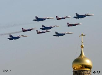 Fighter jets fly over a Russian church tower