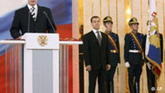 Russian President-elect Dmitry Medvedev, right, greets German Chancellor Angela Merkel during their meeting outside Moscow, Saturday, March 8, 2008. (AP Photo/RIA-Novosti, Dmitry Astakhov, Pool)