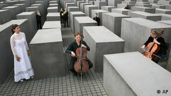 Berlin symphony musicians play at the Holocaust memorial in Berlin on May 9, 2008