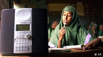 Habiba Maalim, center, and other girls at Khadija Umul Mumminin girls' primary school in Mandera, northeastern Kenya listen to an English lesson broadcast on a WorldSpace satellite radio in this Wednesday, Nov. 6, 2002 photo. WorldSpace was set up by Noah Samara, an Ethiopian-American, in 1990 in a bid to help spread information in some of the world's poorest countries. (AP Photo/Karel Prinsloo)