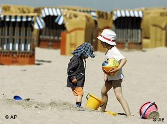 Two children play on the beach at Germany's east coast
