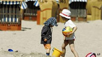 Two kids play on German beach