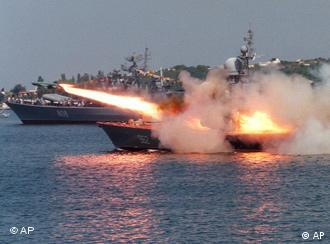 A Russian Navy ship launches a missile during a naval performance, marking Navy Day, in Sevastopol, Crimea, Ukraine