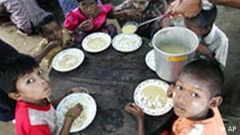 Children in Burma with soup on their plates