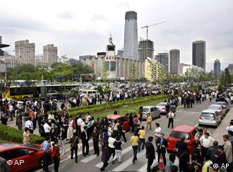 People in Beijing evacuate tall office buldings after the earthquake