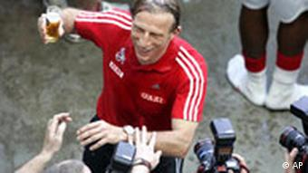 Cologne's coach Christoph Daum jokes with the photographers after the German second division Bundesliga soccer match between 1.FC Cologne and Mainz 05 in Cologne Sunday, May 11, 2008. Cologne advanced to the first division.