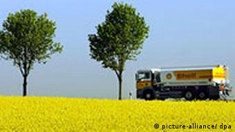 A fuel truck in a field of oilseed rape