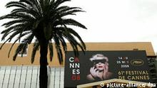 A giant canvas of the official poster of the 61th Cannes Film Festival is seen at the Festival Palais, in Cannes, France, 13 May 2008, one day before the opening of the 61st International Cannes film festival. The festival takes place until 25 th May. EPA/GUILLAUME HORCAJUELO +++(c) dpa - Report+++