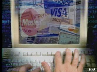Computer screen showing collage of credit cards, partial graphic e-commerce