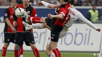 Aleksandar Vasoski from Frankfurt, front, and Angelos Charisteas from Nuremberg, beck, challenge for the ball during the German first division Bundesliga soccer match between Eintracht Frankfurt and 1. FC Nuremberg in Frankfurt, Germany, on Saturday, April 5, 2008. (AP Photo/Daniel Roland) ** EDS PLS NOTE German spelling of Nuremberg is Nuernberg ** ** NO MOBILE USE UNTIL 2 HOURS AFTER THE MATCH, WEBSITE USERS ARE OBLIGED TO COMPLY WITH DFL-RESTRICTIONS, SEE INSTRUCTIONS FOR DETAILS **