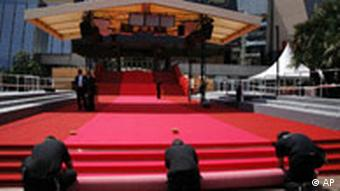 Workers roll out red carpets