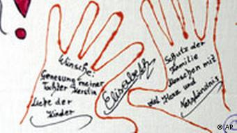 Detail of a poster painted by victims of the Austrian incest crime, which hangs in a window at the main square in Amstetten.