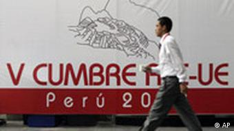 A man walks by a sign that reads in Spanish V Summit Peru 2008 at the site of an upcoming summit in Lima, Wednesday May 14, 2008. Heads of state from Europe, Latin America and the Caribbean will meet in Peru Friday to discuss climate change, trade, poverty and the global food crisis. (AP Photo/Esteban Felix)
