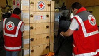 German Red Cross workers packing boxes with aid to be sent abroad