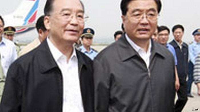 In this photo distributed by the official Chinese news agency Xinhua, Chinese Premier Wen Jiabao, left, greets President Hu Jintao, right, upon Hu's arrival in Mianyang, a city in quake-hit southwestern Sichuan province, on Friday May 16, 2008. (AP Photo/Xinhua, Ju Peng)