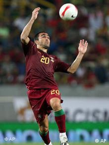 Portugal's national soccer team player Deco controls the ball