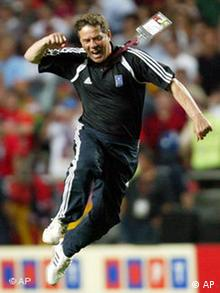 German coach of Greece, jumps in celebration at the end of the Euro 2004 soccer championship final match between Portugal and Greece at the Luz stadium in Lisbon, Portugal, Sunday, July 4, 2004. Greece won 1-0 and clinched the trophy. Copyright: AP Photo/Thomas Kienzle