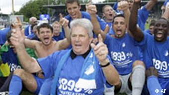 Hoffenheim's sponsor Dietmar Hopp, front, celebrates with the players