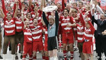 FC Bayern Munich celebrate with the Bundesliga trophy in 2008