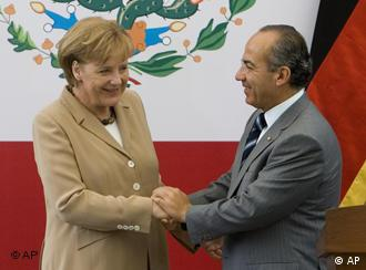 Germany's Chancellor Angela Merkel, left, shakes hands with Mexico's President Felipe Calderon during a welcoming ceremony at the national palace in Mexico City, Monday, May 19, 2008.