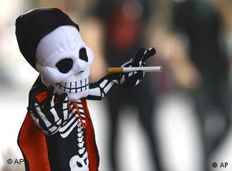 A little toy in the form of a cigarette smoking skeleton