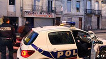 French police car parked in front of house where an ETA member was arrested