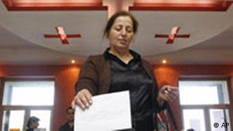 A Georgian woman casts her ballot at a polling station in Tbilisi, Georgia, Wednesday, May 21, 2008