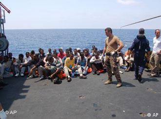 Immigrants on an Italian patrol boat near the Lampedusa island