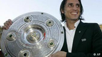 Portugal national player and team captain of VfB Stuttgart Fernando Meiro holding silver plated trophy